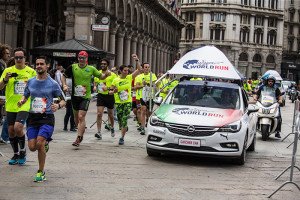 Event participants cheers the catcher car during the Wings for Life World Run in Milano, Italy on May 8, 2016.